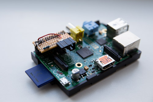 """Raspberry Pi with my serial communication """"level converter"""". It still fits in the RPi's housing, so I'm happy."""
