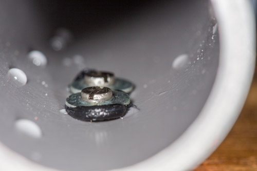 Two stainless steel 2,5mm screws mounted inside the sewer pipe. Any water flowing past can be measured!